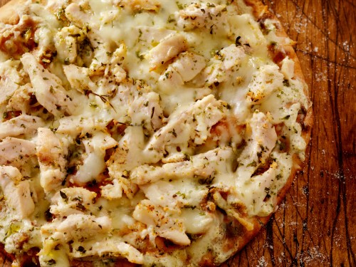 Authentic Italian, Hand Made Grilled Chicken Flat Bread with Fresh Parmesan and an Alfredo Sauce. Could also be Ranch Chicken or Chicken Ceaser- Photographed on a Hasselblad H3D11-39 megapixel Camera System
