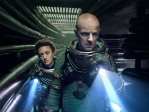 """NIGHTFLYERS -- """"The Sacred Gift"""" Episode 106 -- Pictured: (l-r) Maya Eshet as Lommie, Brian F. O'Byrne as Auggie -- (Photo by: Jonathan Hession/Syfy/NBCU Photo Bank via Getty Images)"""