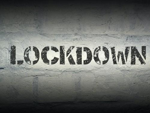 lockdown stencil print on the grunge white brick wall